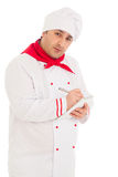 Cook man whriting something in notebook with pen Stock Images