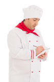 Cook man whriting something in notebook with pen Royalty Free Stock Image