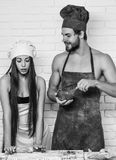 Cook master class. Man and girl on kitchen. Cook master class. Handsome men or muscular cook, baker, with sexy, muscle torso, body, with biceps, triceps and stock photography