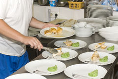 Cook a meal in the restaurant lays Royalty Free Stock Photo
