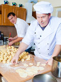 Cook men in kitchen Royalty Free Stock Images