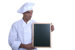 COOK WITH MENU POSTER. ISOLATED Royalty Free Stock Photography