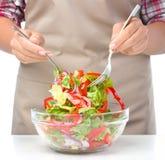 Cook is mixing salad Stock Photos
