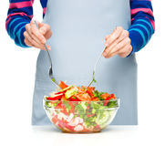 Cook is mixing salad Royalty Free Stock Image