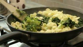 Cook orecchiette cime di rapa pan blend pasta mix italian apulia food.  stock footage