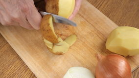 Cook peeling potatoes close up stock video footage