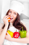 Cook with peppers Stock Images