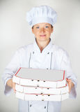 Cook with a pizza in the box Stock Photo