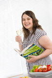 Cook - plus size happy woman holding cookbook Stock Photography