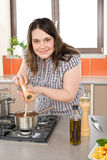 Cook - plus size happy woman with Italian food Royalty Free Stock Image