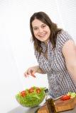 Cook - Plus size happy woman preparing salad Stock Images
