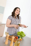 Cook - Plus size happy woman preparing salad Royalty Free Stock Photo