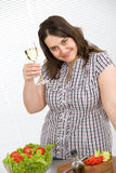 Cook - Plus size happy woman with white wine Stock Photo
