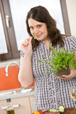 Cook - plus size woman with herb and vegetable Stock Images