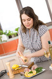 Cook - plus size woman prepare fish Stock Photography