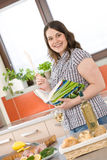 Cook - plus size woman prepare fish meal Royalty Free Stock Photo