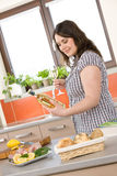 Cook - plus size woman prepare fish with wine Stock Photos