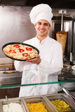 Cook posing with Italian pizza Stock Photo