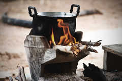 Cook on pot at the charcoal brazier Stock Photos