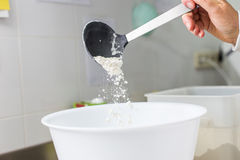 Cook pouring flour Royalty Free Stock Photography