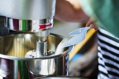Cook is pouring sugar to make bakery. Cook is pouring sugar to make bakery royalty free stock image