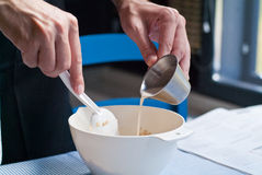 Cook pouring sweet cream Royalty Free Stock Images