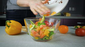 Cook pours in a bowl salad ingredients stock video