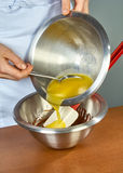 Cook prepares chocolate cream for cake royalty free stock image