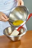 Cook prepares chocolate cream for cake royalty free stock photo