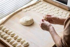 Cook prepares dumplings Royalty Free Stock Photography