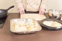 Cook prepares empanadas Stock Photos