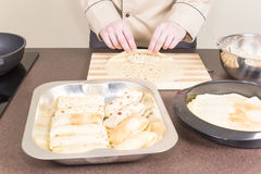 Cook prepares empanadas Stock Photo