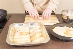Cook prepares empanadas Stock Image