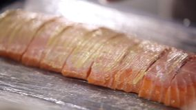The cook prepares fish for frying. Fillet of a salmon. The cook cooks fish. Red fish. Cook`s hands close. Preparations. Slicing salmon fillets. The cook prepares stock video