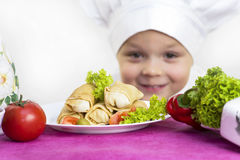 Cook prepares food Royalty Free Stock Photography