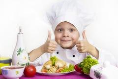 Cook prepares food Royalty Free Stock Photos