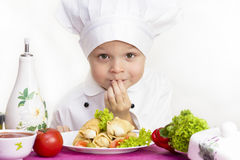 Cook prepares food. At the table Stock Photography