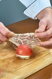 Cook prepares lamb ribs cooking process stock photo
