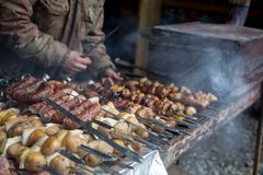 The cook prepares meat on the skewer. Royalty Free Stock Photography
