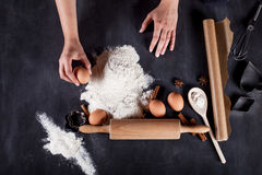 Cook preparing cookies from eggs, flour, cinnamon and anise Royalty Free Stock Image