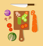 Cook and preparing. Cutting vegetables. Royalty Free Stock Photos