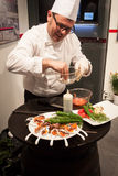 Cook preparing finger food at Bit 2014, international tourism exchange in Milan, Italy Stock Photography