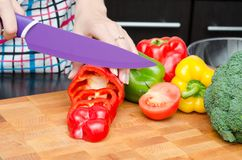 Cook preparing food, cut the peppers into slices Stock Photography