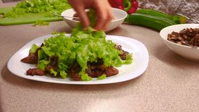 Cook preparing hot, dietary salad with beef and champignons. stock video footage
