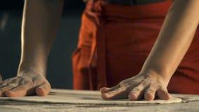 Cook preparing pizza dough. Slow Motion