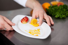 Cook preparing plate of dessert Royalty Free Stock Image