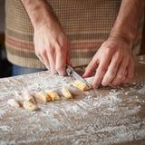 Cook preparing raw pumpking gnocchi stock photography