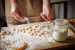 Cook preparing raw pumpking gnocchi Stock Images