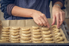 Cook preparing traditional crescent biscuits Royalty Free Stock Images