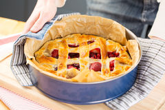 Cook presenting homemade pie Royalty Free Stock Photos